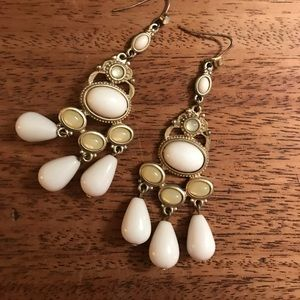 White and gold costume jewelry earrings